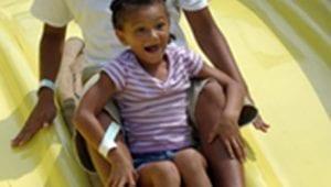 Girl Sliding Down Kid Friendly Ride at Lake Winnie