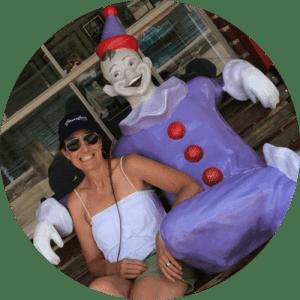 Woman Sitting Next to Clown Statue at Lake Winnie