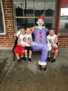 Kids Sitting Next to Clown at Lake Winnie
